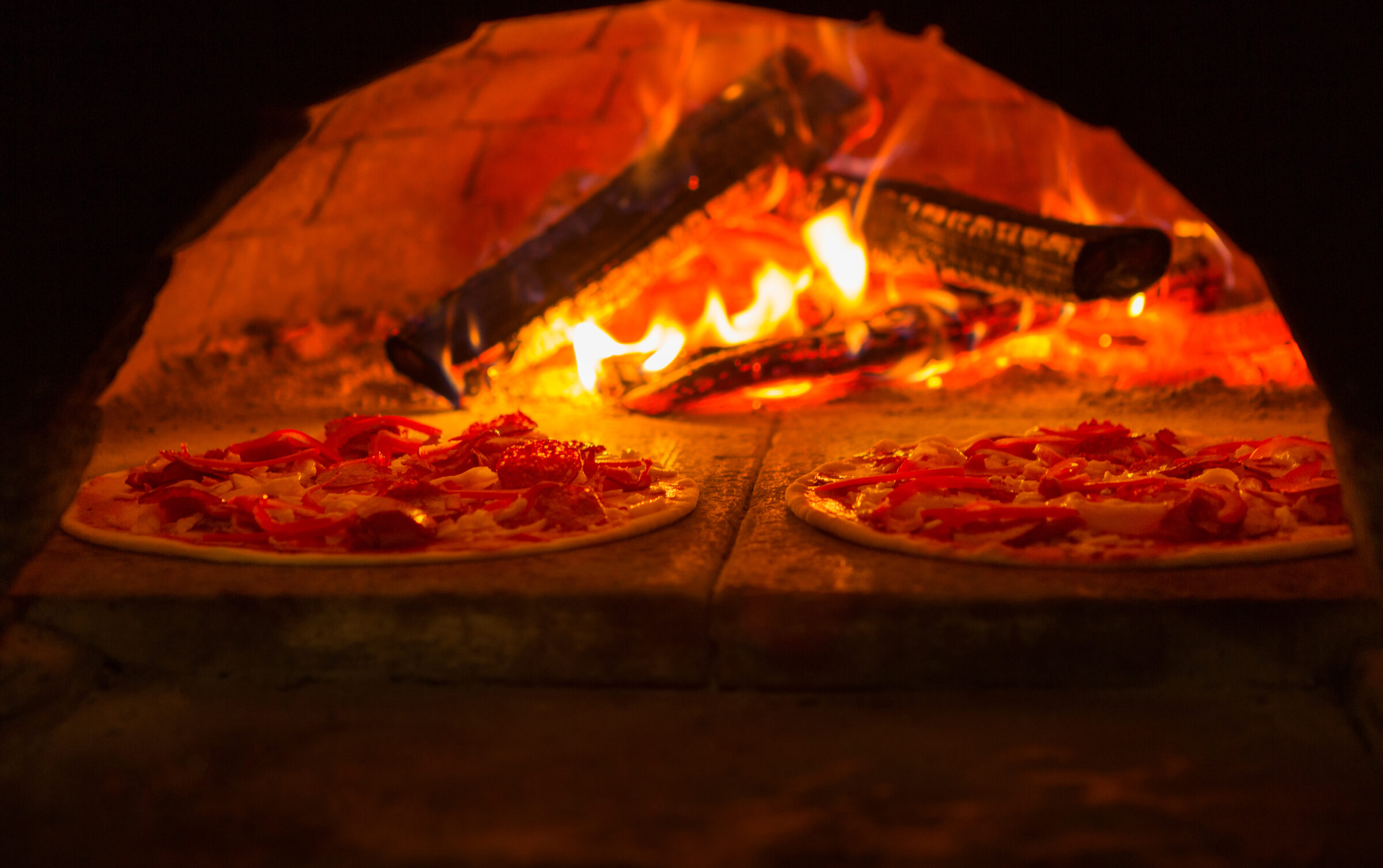 Italian pizza is cooked in wood fired oven